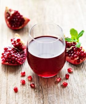 Pomegranate juice with fresh pomegranate fruits