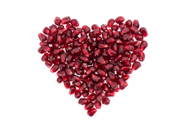 Pomegranate seeds isolated on white.