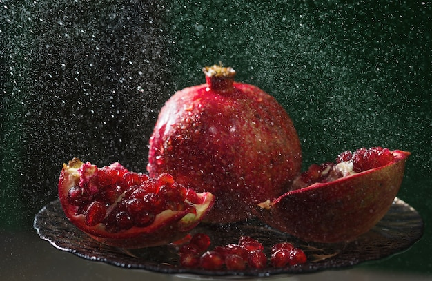 Pomegranate in spray of water.