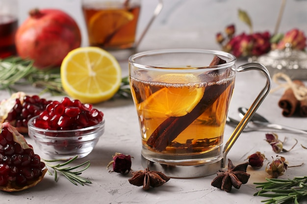 Pomegranate tea with lemonnd cinnamon stick in two transparent cups