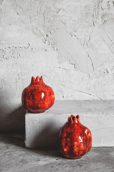 Pomegranate vase on a gray background. vintage style