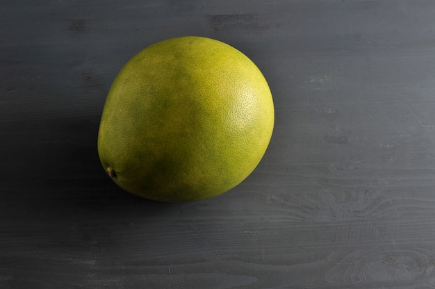 Pomelo on dark wooden rustic surface