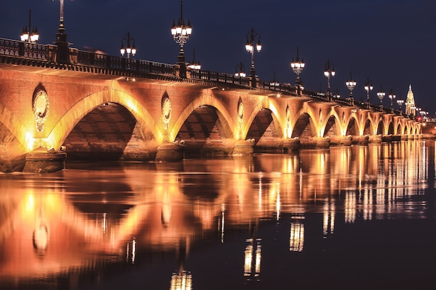Pont de pierre bridge at twilight, bordeaux, france