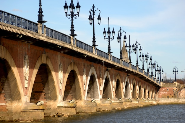 Pont de pierre stone bridge on river garonne in bordeaux