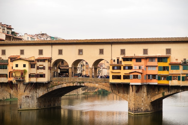 Ponte vecchio over arno river in florence, italy.
