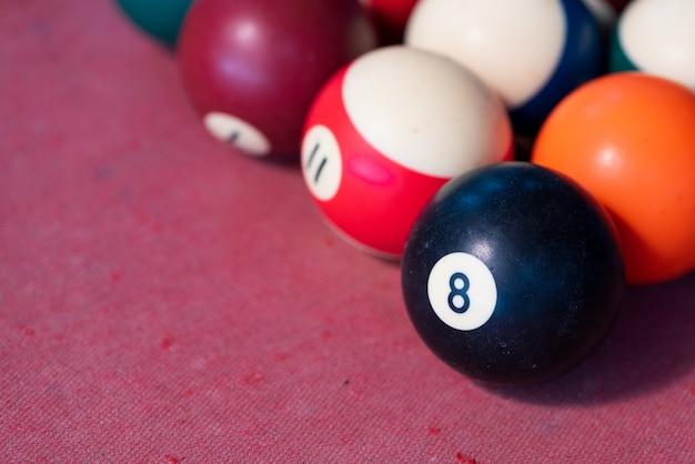 Pool balls on red felt table.