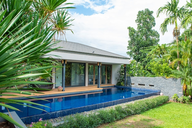Pool in modern house and mountain view