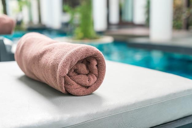 Pool towel on chair decoration around swimming pool