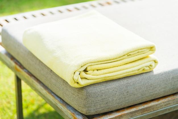 Pool towel on chair in luxury hotel resort