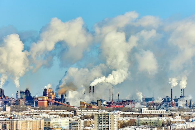 Poor environment in the city. environmental disaster. harmful emissions into the environment. smoke and smog. pollution