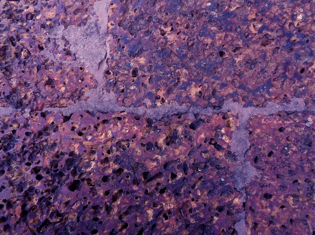 Pop art style purple colored rough old stone floor surface