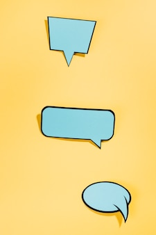 Pop art style speech bubbles on yellow backdrop