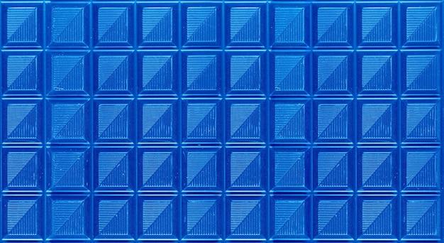 抽象的な背景のためのポップアートシュールなスタイルのロイヤルブルー色のチョコレートバー