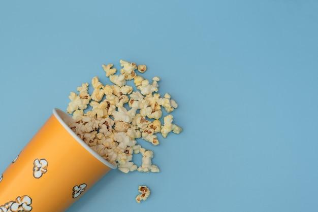 Popcorn on blue. movie night concept.
