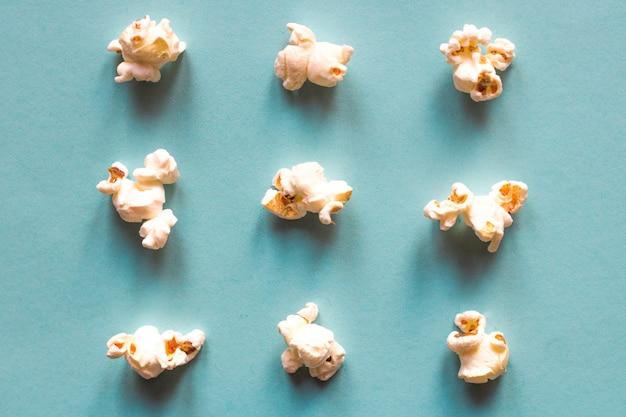 Popcorn on blue pastel background. movie snack. top view