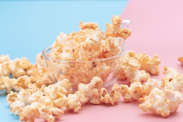 Popcorn in a bowl on blue and pink