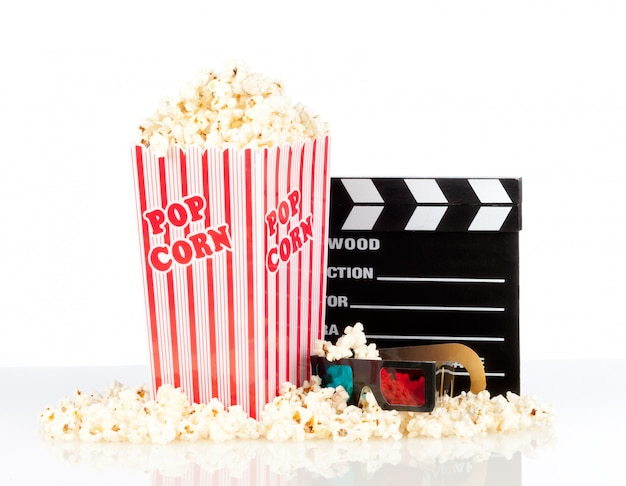 Popcorn box with clapper board and 3d movie glasses on white