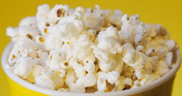 Popcorn box on yellow background.