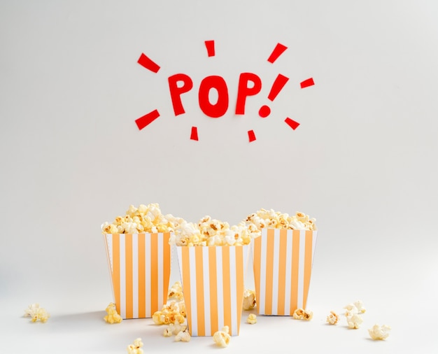 Popcorn boxes with pop sign above