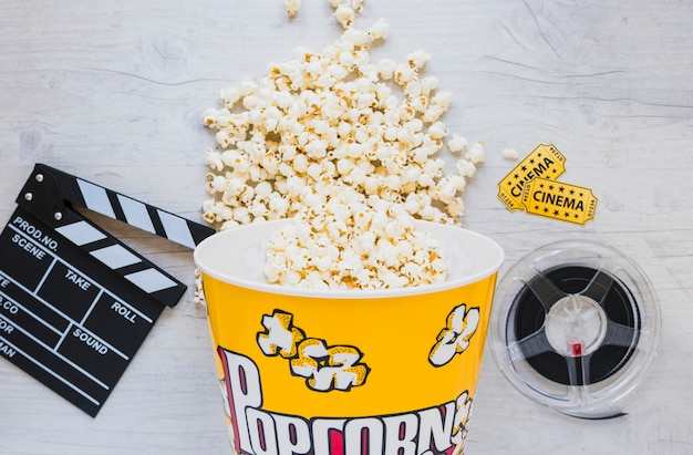 Popcorn bucket and filmstrip on table