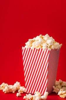 Popcorn bucket with red background