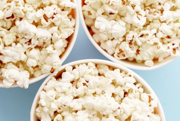 Popcorn in buckets. three buckets with popcorn, top view.