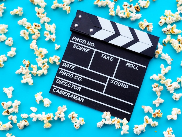 Popcorn and clapperboard. the concept of movie, film, entertainment, advertising