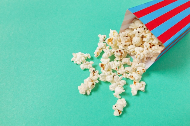 Popcorn on color background