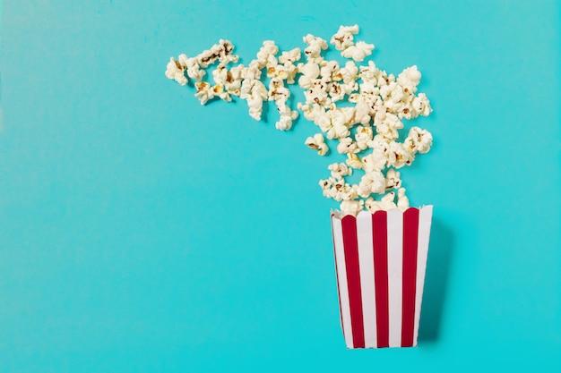 Popcorn on color background