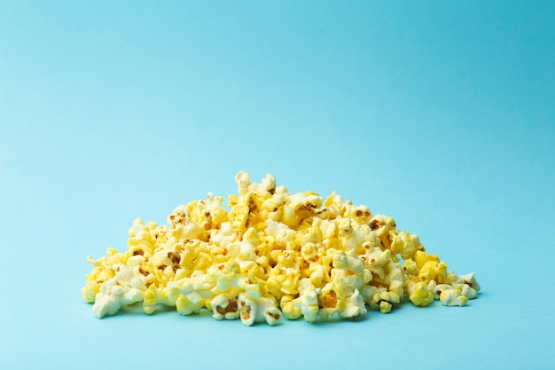 Popcorn on a colored background. minimal food concept. entertainment, film and video content. aesthetics 80s and 90s concept