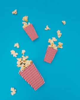 Popcorn composition on blue background