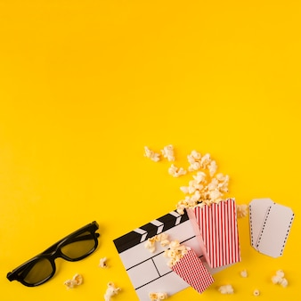 Popcorn composition on yellow background with copy space