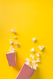 Popcorn composition on yellow background