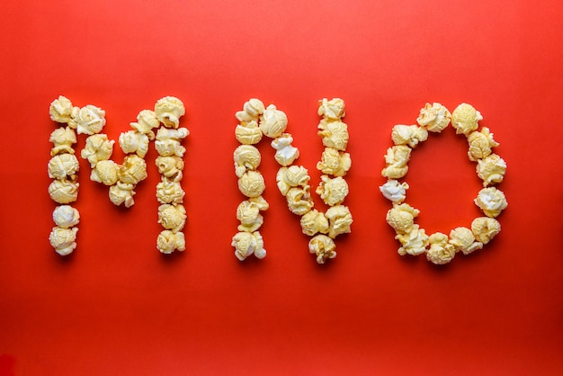 Popcorn forming letter m,n,o on red background