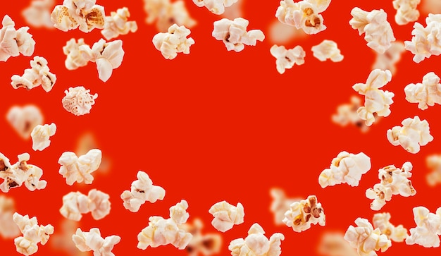 Popcorn frame, flying popcorn isolated on red