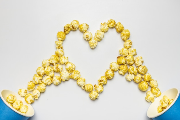 Popcorn heart shaped concept, copy space. isolated white background