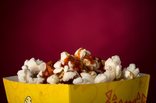 Popcorn isolated in red background