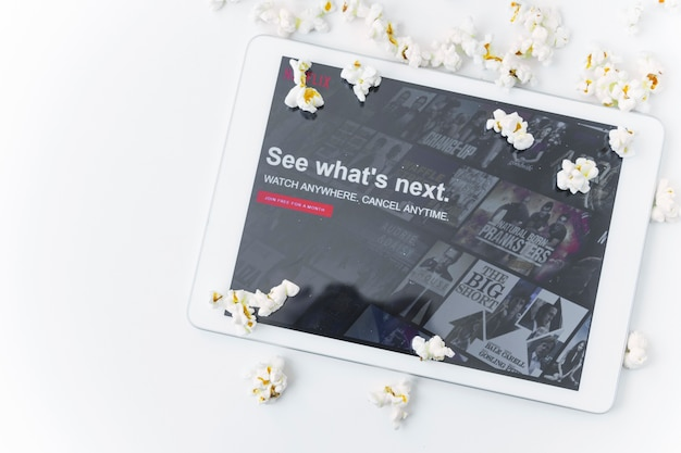 Popcorn near tablet with netflix site