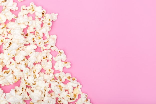 Popcorn on pink background. movie or tv background, border, frame. top view copy space