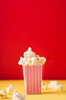 Popcorn on red background with copy space