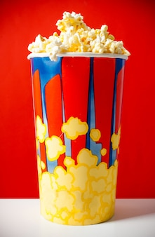 Popcorn in striped bucket