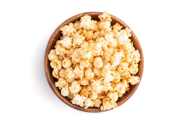Popcorn with caramel in wooden bowl
