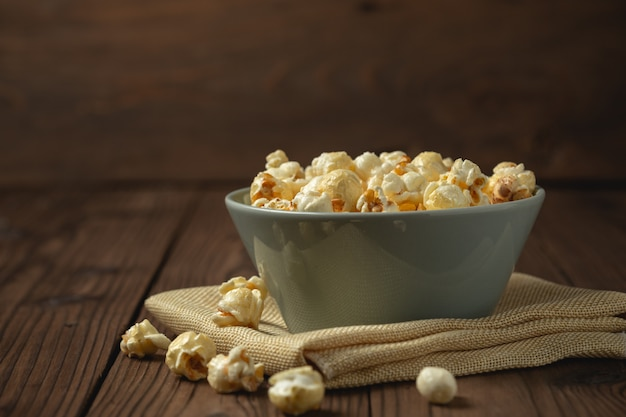 Popcorn on the wooden table.