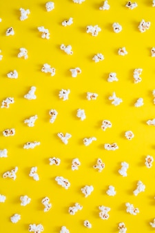 Popcorns on yellow background