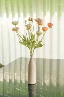 Poppy flower in vase decoration on dinning table