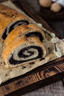 Poppy seed cake on wooden easter table.