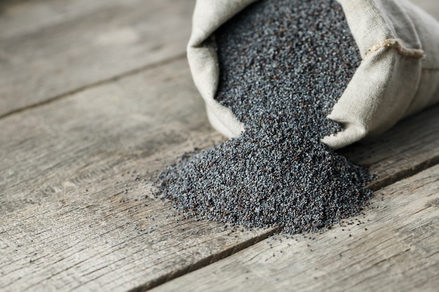 Poppy seeds in a burlap bag. the tasty and useful seeds rich with protein and oils.