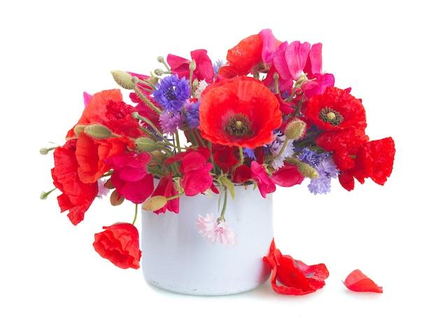 ポピー、スイートピー、ブルーコーンの花をポットに分離