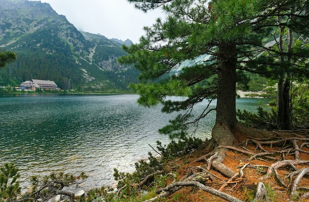 Popradske pleso and high tatras summer cloudy mountain view (slovakia)