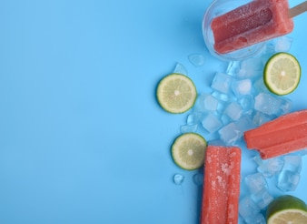 Popsicle and lemon on a blue background